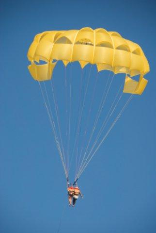 Couple parasailing over Smathers Beach Florida